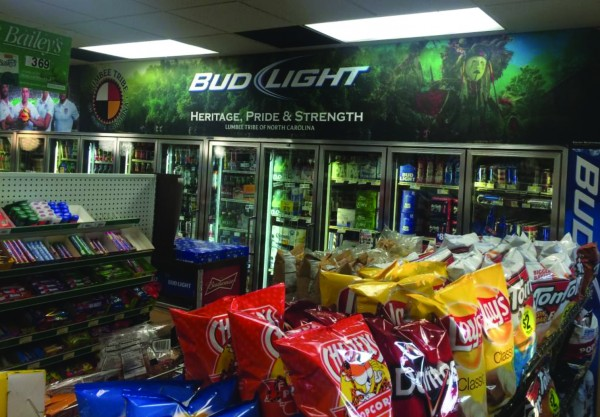 A refrigerator at a convenience store in Raeford has a Bud Light advertising display above it that has drawn the ire and a lawsuit from the Lumbee Tribe of North Carolina. (Image from lawsuit filing)