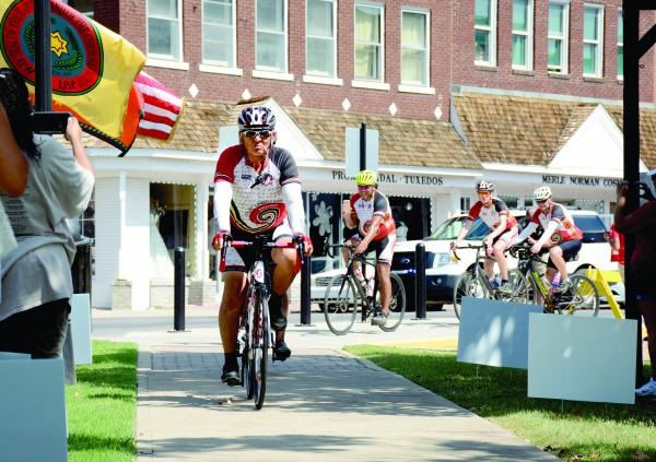 Remember the Removal Bike Ride Elder Ambassador and Cherokee Nation citizen Sammy Houseberg leads the cyclists to the Cherokee Nation Courthouse as they complete the nearly 1,000 mile trek. (Cherokee Nation photos)