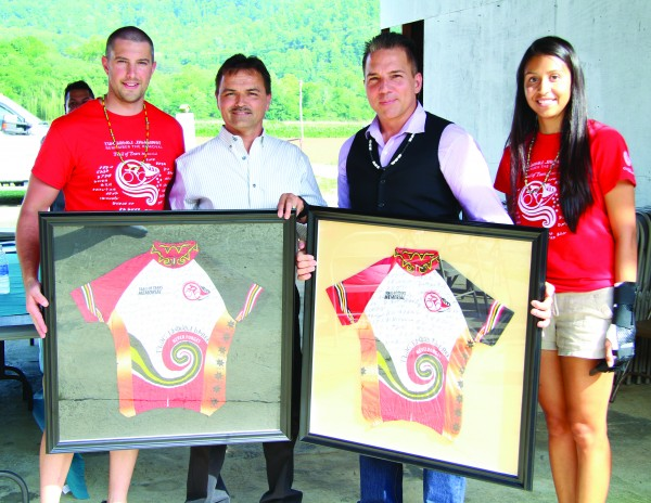 Cherokee Nation Removal Riders support staff Kevin Jackson (left) and Sarah Holcomb (right) present 2016 jerseys to Principal Chief Patrick Lambert and Vice Chief Richard G. Sneed. (SCOTT MCKIE B.P./One Feather)