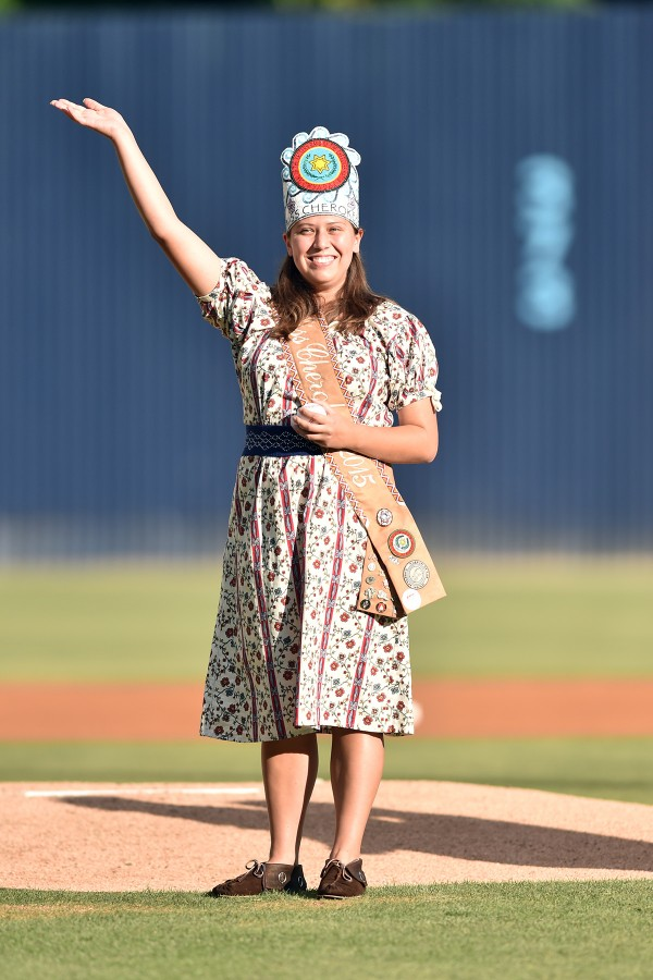 Miss Cherokee Taran Swimmer waves to the crowd before throwing the first pitch at an Asheville Tourists game on Cherokee Night on June 17.  (Photo courtesy of Tina Swimmer)