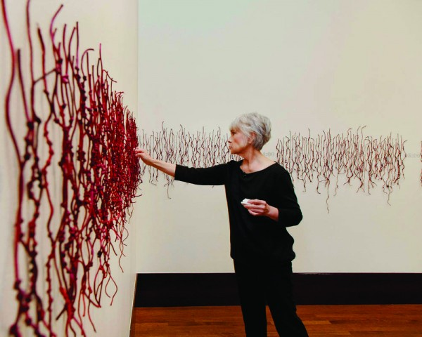 """EBCI tribal member Luzene Hill works on an art installation entitled """"Retracing the Trace"""" at the Eiteljorg Museum in Indianapolis.  She was recently named a Native Arts and Cultures Foundation (NACF) National Artist Fellow. (Photos courtesy of Luzene Hill)"""