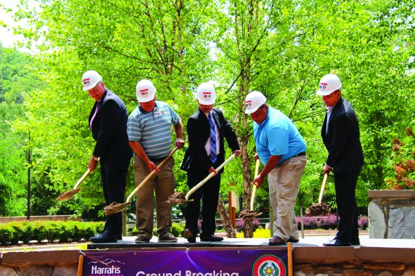 Ground was officially broken for the new Bowling Entertainment Center at Harrah's Cherokee Casino Resort on Tuesday, July 9. Shown (left-right) are Brooks Robinson, Harrah's Cherokee regional senior vice president and general manager; Jim Owle, TCGE Board of Advisors chairman; Principal Chief Patrick Lambert; Tribal Council Chairman Bill Taylor; and Vice Chief Richard G. Sneed. (SCOTT MCKIE B.P./One Feather photos)