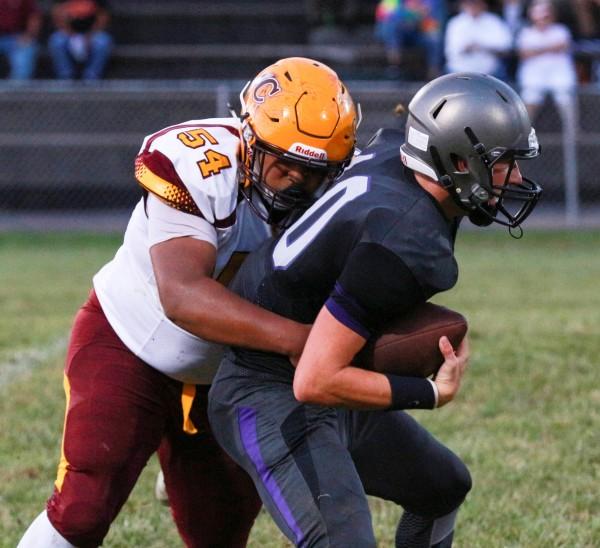 Cherokee's Zak Perez (#54), junior defensive lineman, sacks Grayson Vaughn, Trinity's junior quarterback.