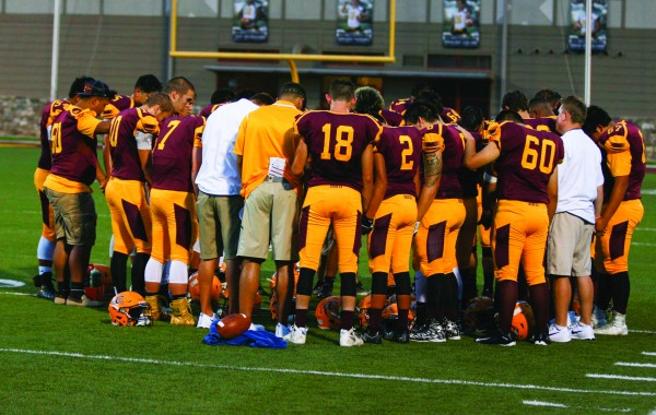 Cherokee players and coaches gather for a moment of prayer as a Braves player is taken off of the field following an injury. Out of respect for the privacy of student-athletes and their families, it is the policy of the One Feather to not identify those who have been injured during sports games. We send our sincerest thoughts and prayers to the young man and his family.