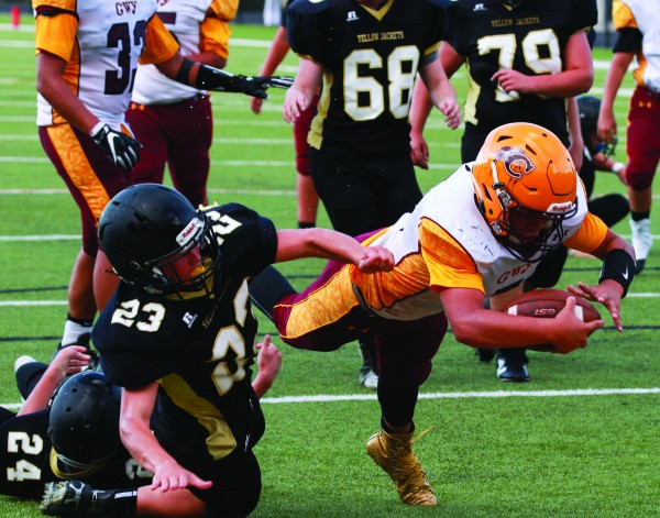 Bobby Crowe, JV Braves quarterback, dives into the end zone at the end of a 19-yard touchdown run in the first half of Thursday's game at Hayesville. He ended the game with two rushing touchdowns and two passing touchdowns. (SCOTT MCKIE B.P./One Feather photos)