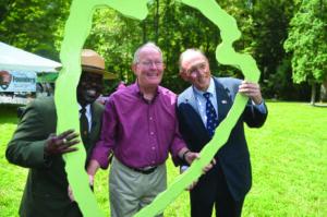 "Smokies Park Superintendent Cassius Cash, Sen. Lamar Alexander, and Congressman Phil Roe pose in a National Park Service ""arrowhead""."