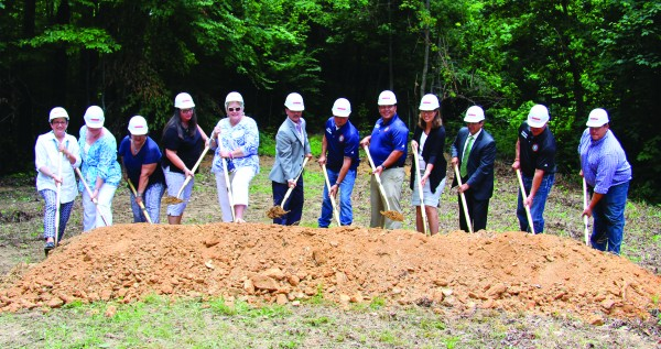 EBCI tribal officials broke ground on the future Snowbird Residential Treatment Center on Wednesday, July 13. They are shown (left-right) Dr. Frances Owle-Smith, Cherokee Indian Hospital Authority (CIHA) Governing Board member; Helene Lambert, CIHA Governing Board member; Marcia Hollifield, CIHA Governing Board member; Vickie Bradley, EBCI Secretary of Public Health and Human Services; Painttown Rep. Tommye Saunooke; Principal Chief Patrick Lambert; Wolfetown Rep. Bo Crowe; Cherokee County – Snowbird Rep. Adam Wachacha; Yellowhill Rep. Anita Lossiah; Casey Cooper, Cherokee Indian Hospital CEO; Tribal Council Vice Chairman Brandon Jones; and Birdtown Rep. Travis Smith. (SCOTT MCKIE B.P./One Feather)