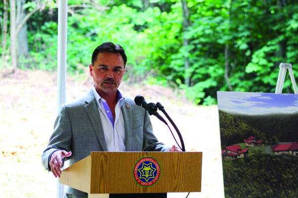 Principal Chief Patrick Lambert speaks during the groundbreaking ceremony for the future Snowbird Residential Treatment Center on Wednesday, July 13. (SCOTT MCKIE B.P./One Feather)