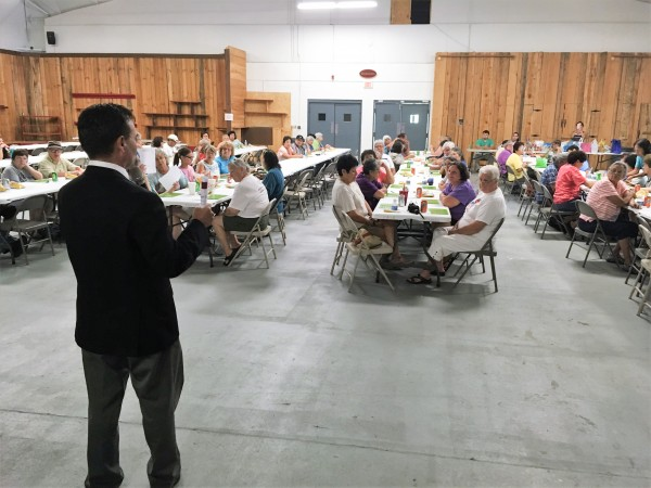 Principal Chief Patrick Lambert speaks to seniors at a Bingo Night event at the Cherokee Indian Fairgrounds on Thursday, July 28. (EBCI Communications photo)