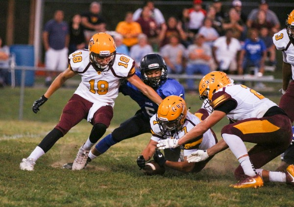 Cherokee's George Swayney (#7) recovers a fumble in the first half.