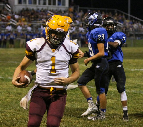 Tye Mintz, Braves junior quarterback, runs for a two-point conversion in the second quarter. On the night, he completed 13 of 21 passes for 235 yards and four touchdowns.