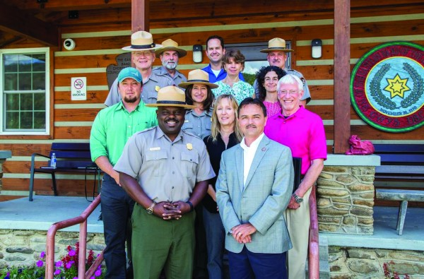 Chief Lambert (front, right) met with Cassius Cash (front, left), Great Smoky Mountains National Park superintendent, and other National Park Service officials on Monday, Aug. 1 to discuss plant gathering rules in the Park. (EBCI Communications photos)