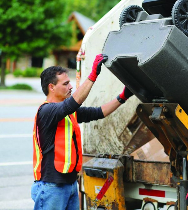 Chief Lambert works on an EBCI sanitation crew early in the morning on Saturday, Aug. 20.