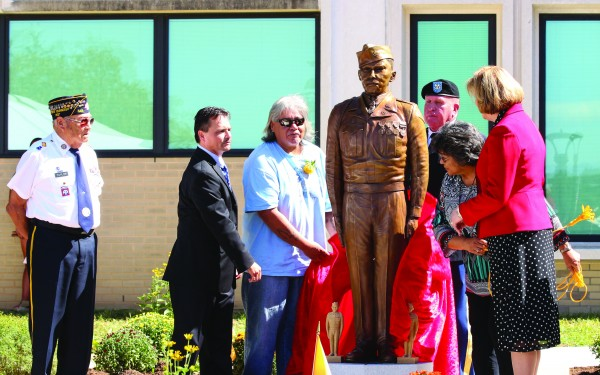 AMERICAN HERO: A life-size statue of PFC Charles George, an EBCI tribal member and Medal of Honor recipient, was unveiled at the Charles George VA Medical Center in Asheville on Saturday, Sept. 24. (SCOTT MCKIE B.P./One Feather)