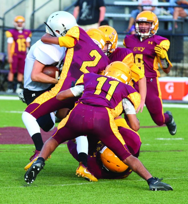 Cecil Walkingstick (#2) tackles a Robbinsville running back in the first half. He led Cherokee with 11 tackles.