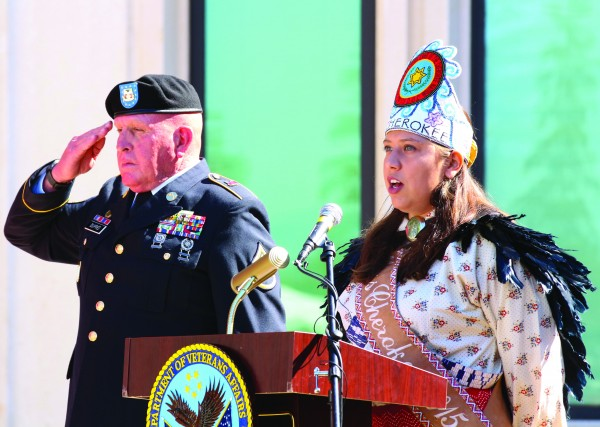 """ANTHEM: Miss Cherokee Taran Swimmer sings the """"Cherokee National Anthem"""", as Warren Dupree stands at attention, at an unveiling ceremony for a statue honoring PFC Charles George at the Charles George VA Medical Center in Asheville on Saturday, Sept. 24. (SCOTT MCKIE B.P./One Feather)"""