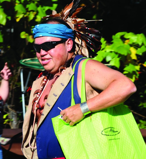 """WARRIOR: Bo Taylor, a member of the Warriors of Anikituwah, hands out candy at last year's Cherokee Indian Fair Parade. This year's event is set for Tuesday, Oct. 4 with the them """"Living Cherokee Strong""""."""