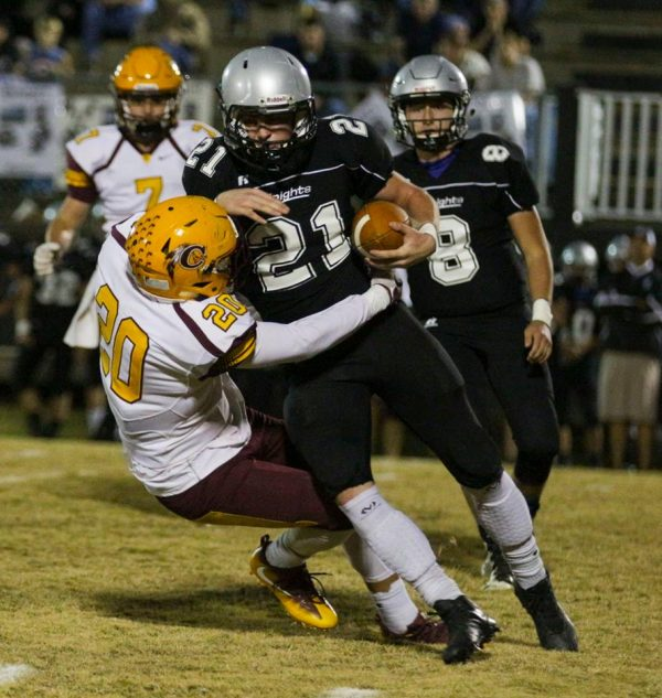 BIG NIGHT: Holden Straughan, Braves junior linebacker, puts a hit on Robbinsville's Ian Wiggins during a game at Big Oak Stadium on Friday, Oct. 28. Straughan had a big night finishing with 12 tackles. (SCOTT MCKIE B.P./One Feather photos)