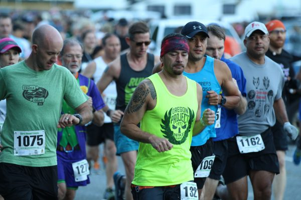 James Oocumma (#), an EBCI tribal member, starts with the pack in the Cherokee Harvest Half Marathon on Saturday, Oct. 1.  He finished 43rd overall with a time of 1:39:42.  (SCOTT MCKIE B.P./One Feather)