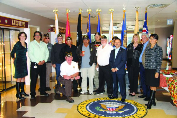 INPUT: Tribal leaders and veterans of the Eastern Band of Cherokee Indians gather for a group shot prior to Friday's consulation meeting.