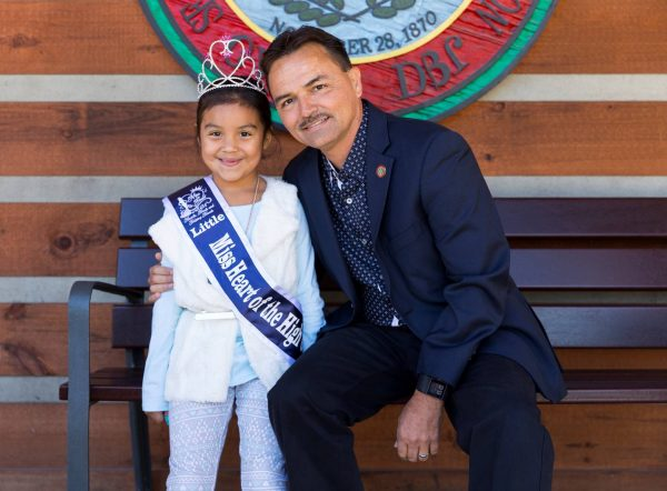 Keneya Jade Simpson, who recently won several awards at the Sunburst USA Beauty Pageant in Asheville, is shown with Principal Chief Patrick Lambert on Friday, Oct. 21.  (EBCI Communications photos)