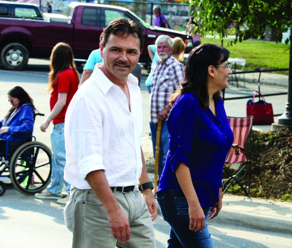 Chief Lambert and his wife, Cyndi, walk during the annual Cherokee Indian Fair Parade on Tuesday, Oct. 4. (SCOTT MCKIE B.P./One Feather)