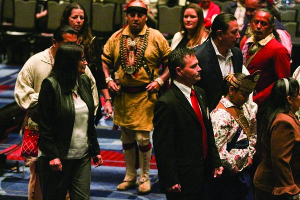 Chief Lambert (center foreground) participates in the Cherokee Friendship Dance, led by the Warriors of Anikituwah, at the opening session of the USET Annual Meeting at Harrah's Cherokee Casino Resort on Monday, Oct. 24. (SCOTT MCKIE B.P./One Feather)