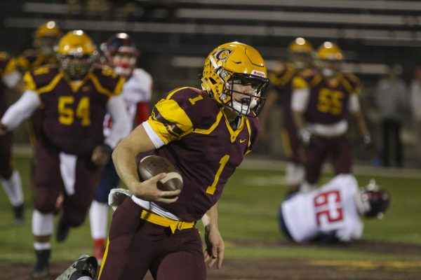 BIG RUN: Tye Mintz (#1), Braves junior quarterback, runs up the middle enroute to 63-yard touchdown run in the third quarter. On the night, Mintz completed 4 of 8 passes for 83 yards and two touchdowns, and he ran 17 times for 213 yards and three scores. (SCOTT MCKIE B.P./One Feather photos)