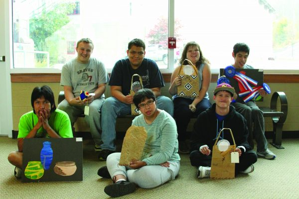 ART WINNERS: The following students in the Life Skills classroom at Cherokee High School recently won awards at several area fairs: shown (left-right) back row – Nathan Gaddis, Jimmy Welch, Destyni Johnson, Daniel Tramper; front row – Dustin Pheasant, Gabby Mejorado, and Andy Watty.  (CCS Photo)