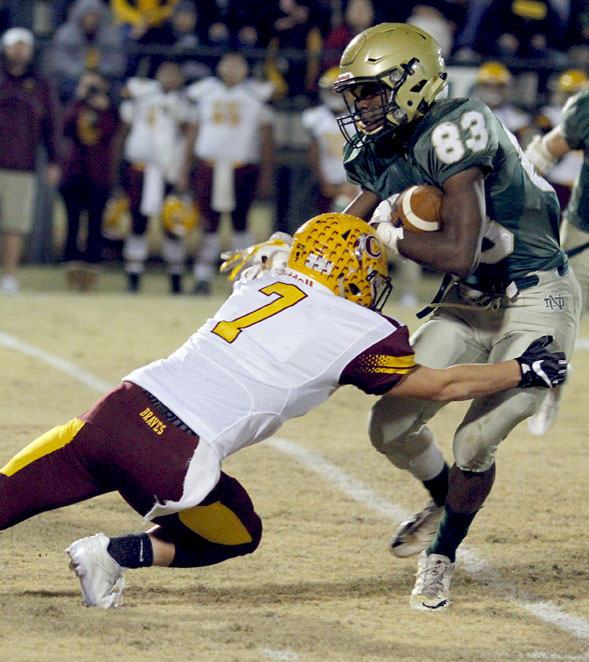 Cherokee's George Swayney (#7) tackles Terrion Addison (#83), North Duplin wide receiver during Friday's playoff game. (Photo by Bobby Williams/Mount Olive Tribune)