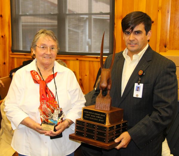 Carmeleta Monteith (left), Cherokee Indian Hospital Authority Governing Board chairperson, and Casey Cooper, Cherokee Indian Hospital chief executive officer, hold the Chief Noah Powell Fiscal Excellence Award received by the Cherokee Indian Hospital Integrated Project Delivery Team during a ceremony during Tribal Council on Thursday, Nov. 3. (SCOTT MCKIE B.P./One Feather photos)