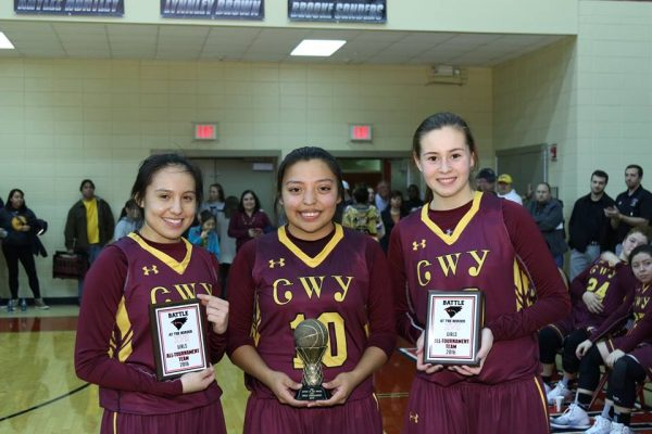 The Lady Braves won the 17th Annual Battle at the Border basketball tournament with a win over Landrum (SC) on Friday, Dec. 30. Raylen Bark (left) was named All-Tournament along with Tori Teesateskie (right). Pooh King (middle) was named Tournament MVP. (Photo courtesy of Cherokee Braves athletic department)