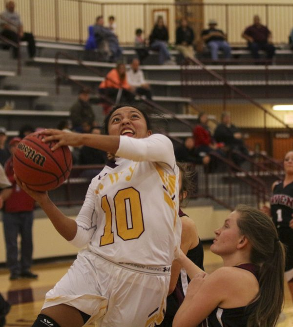 Pooh King (#10), Lady Braves senior point guard, goes strong to the hoop in the first half of Thursday's game against Owen in the second round of the Holidays on the Hardwood tournament. Cherokee won 76-45 to advance to the finals against West Hall (Ga.) on Friday, Dec. 23 at 7pm at the Charles George Memorial Arena. (SCOTT MCKIE B.P./One Feather)