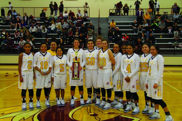 HARDWARE: The Cherokee Lady Braves pose with the second place trophy they won in the Holidays on the Hardwood Tournament played Dec. 21-23 at the Charles George Memorial Arena. (SCOTT MCKIE B.P./One Feather photos)