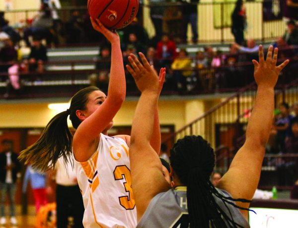 Cherokee's Tori Teesateskie (#30) shoots over Hayesville's Kimonta Lloyd during a home game at Charles George Memorial Arena on Friday, Dec. 9. Teesateskie led Cherokee with 24 points as the Lady Braves won big 65-36 over the Lady Yellow Jackets. (SCOTT MCKIE B.P./One Feather)