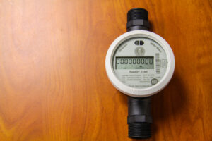 NEW TECHNOLOGY: The EBCI Water & Sewer Department is currently exchanging old, outdated water meters with new Kamstrup meters as shown in the photo above. (SCOTT MCKIE B.P./One Feather)