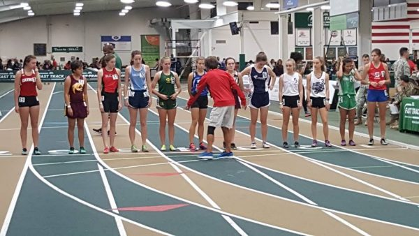 Cherokee's Dorian Reed (second from left) stands ready at the start of the Girls 1600M Run at the indoor Champion Fast Track High School Invitational in Winston-Salem on Saturday, Jan. 14.  (Photo courtesy of Eddie Swimmer/CHS)