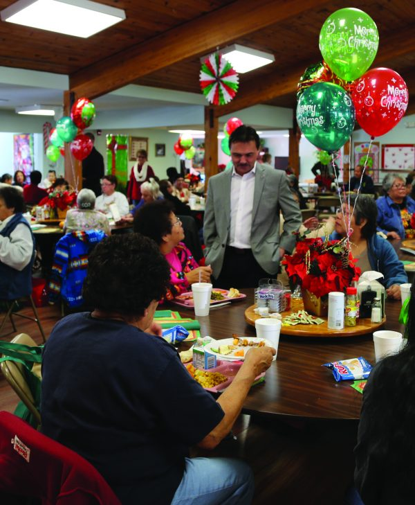 PARTY: Principal Chief Patrick Lambert (standing) visits with EBCI tribal elders at the Tsali Manor Christmas Party on Thursday, Dec. 15. (Photos courtesy EBCI Communications)